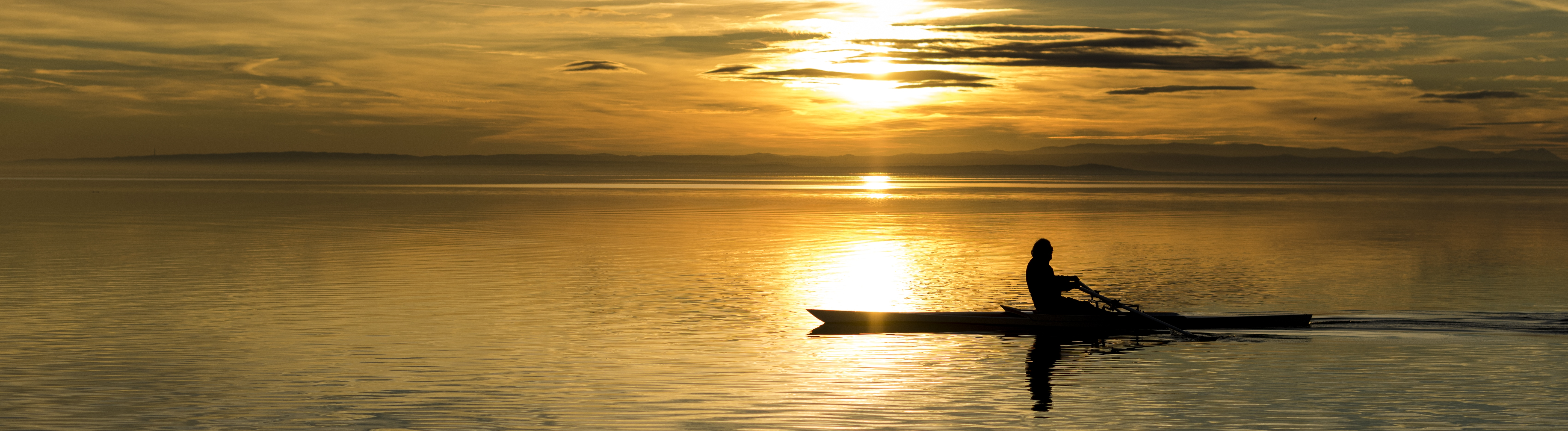 Rower at sunset