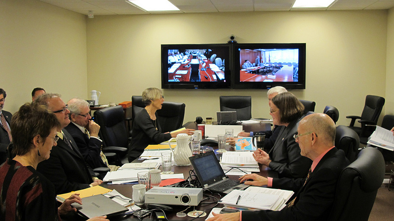 Commissioners and staff converse via videoconference with their colleagues in the IJC's Ottawa and Windsor offices during the November executive meeting.