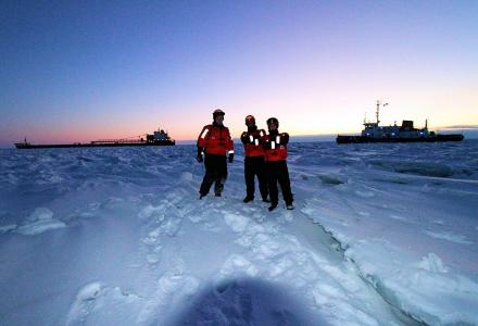 Water Matters - Coast guard officers stand on frozen Lake Huron