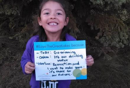 "Water Matters - Young girl holding sign ""I love the Great Lakes because..."""