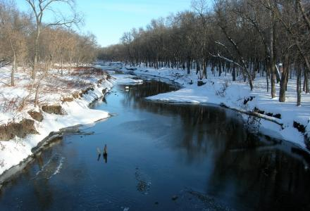 Image of the Souris River during the winter with snow-covered banks