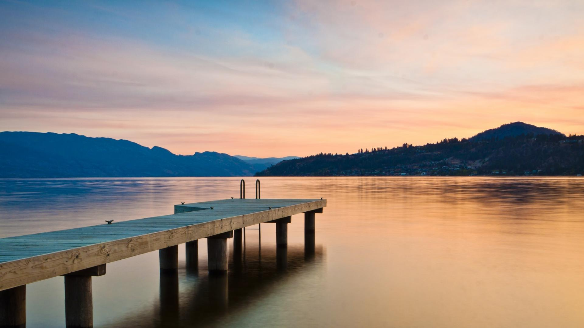 Picture of sunset over Lake Okanagan with view of a dock