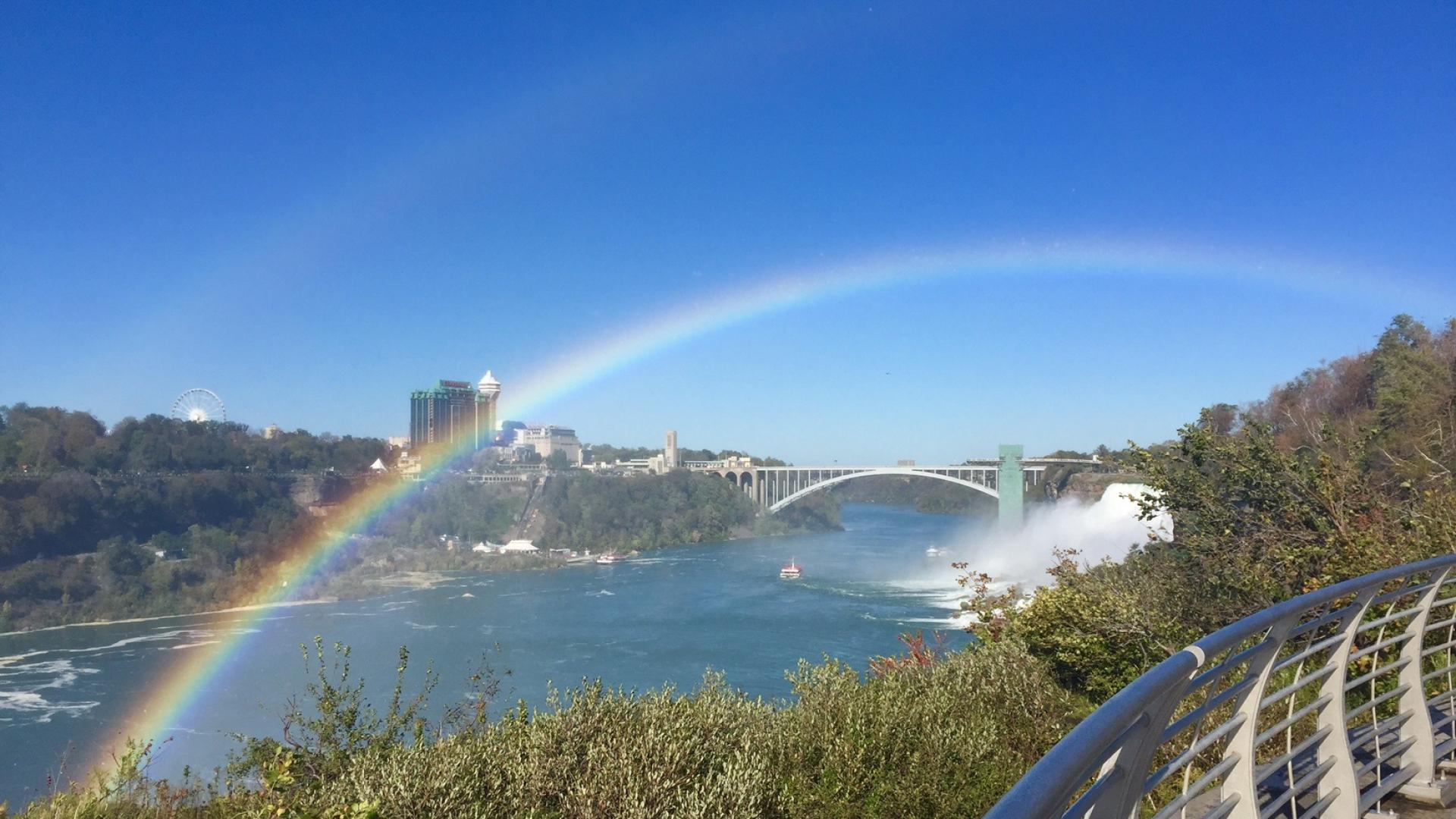 A rainbow shines over the Niagara River.