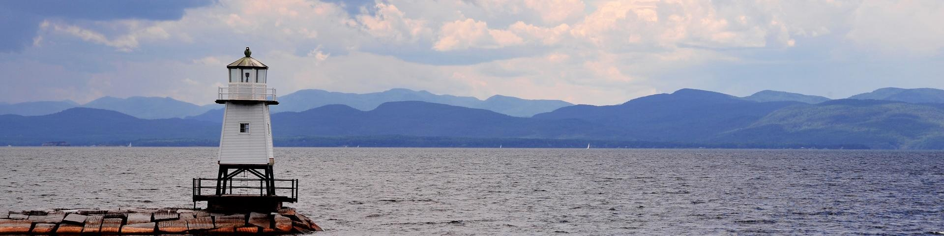 Lighthouse on Lake Champlain with view of mountains